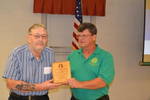 Bill Schlaffer is presented a National Conservation Award by Ray Powell, Chapter President